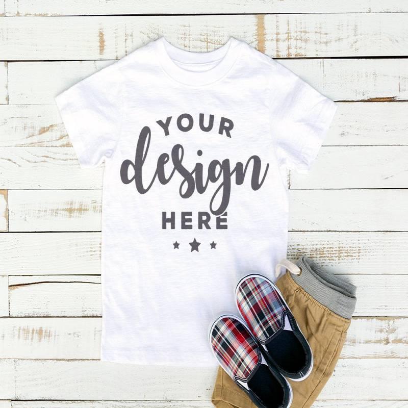 White  Kids Tshirt Mockup On Distressed Wood White Background With Khaki Shorts and Plaid Shoes Hi Resolution Jpeg Image 300 ppi