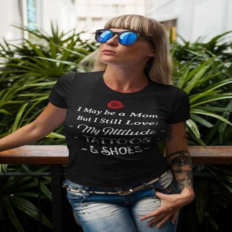 I may be a mom but i still love my attitude tattoos and shoes t shirt